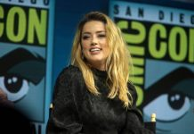 Amber Heard reportedly sleeps close to her guns, says she's 'fully trained'