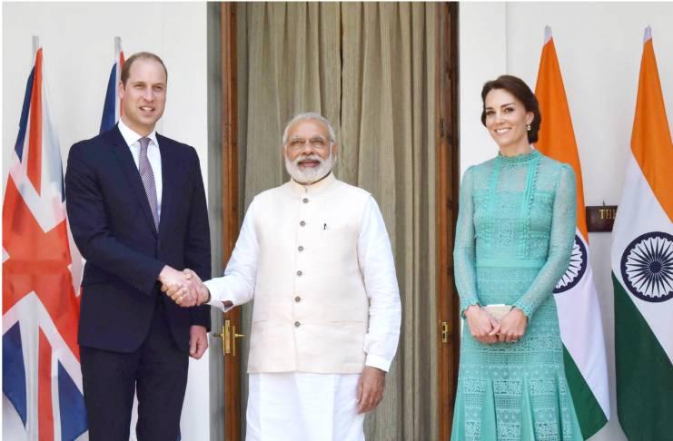 Duke, Duchess of Cambridge helping Queen Elizabeth